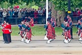 Trooping the Colour 2011: The Band of the Scots Guards, here the Pipers in their Royal Stewart Tartan, marching on Horse Guards Road, before turning onto Horse Guards Parade.. Horse Guards Parade, Westminster, London SW1, Greater London, United Kingdom, on 11 June 2011 at 10:30, image #48