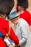 Trooping the Colour 2011: HM The Queen, back at the saluting base after the Inspection of the Line, about to take a seat, with the official programme of the parade in her hand.. Horse Guards Parade, Westminster, London SW1, Greater London, United Kingdom, on 11 June 2011 at 11:08, image #173