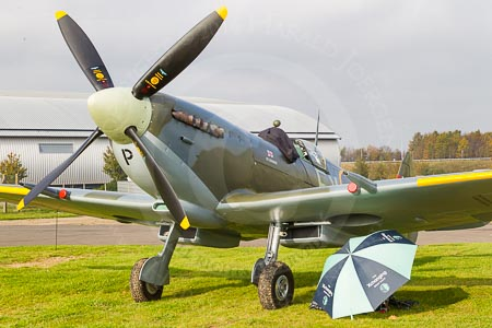 The Spitfire during the photography work at Duxford Aerodrome. The photographer's workplace is under the wing, shielded against the low sun by a Boat Race umbrella.