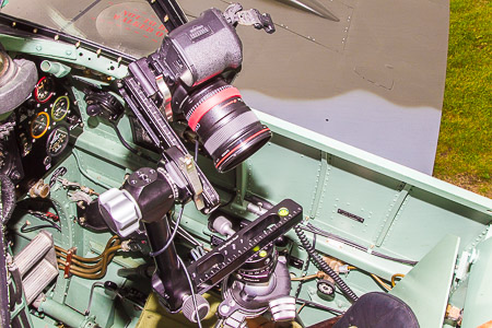 The camera used for the panoramic photography, a Canon 5D Mk II, can be seen mounted on a panoramic head assembly on a tripod inside the Spitfire cockpit