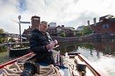 "BCN Marathon Challenge 2013: Skipper Charley on board of NB ""Felonious Mongoose"", at Old Street Junction in the centre of Birmingham, at the start of the BCN Marathon Challenge, opening the sealed envelope with the challenges.. Birmingham Canal Navigation,   United Kingdom, on 25 May 2013 at 07:58, image #28"