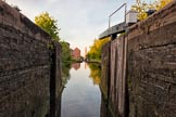 BCN Marathon Challenge 2013: Walsall No. 8 lock, the bottom lock of the eight Walsall Locks, seen from the No. 7 Lock, with Albion Flour Mill next to the bottom lock, and Walsall Junction, near the chimney, behind.. Birmingham Canal Navigation,   United Kingdom, on 26 May 2013 at 05:43, image #344