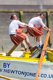 "TOW River Thames Barge Driving Race 2013: Rowers wearing skirts on the deck of of barge ""Hoppy"" by GPS Fabrication.. River Thames between Greenwich and Westminster, London,  United Kingdom, on 13 July 2013 at 12:44, image #191"