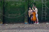 TOW River Thames Barge Driving Race 2013: Two young male musicians playing their instruments by the river.. River Thames between Greenwich and Westminster, London,  United Kingdom, on 13 July 2013 at 13:32, image #353
