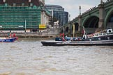 """TOW River Thames Barge Driving Race 2013: Barge """"Diana"""", by Trinity Buoy Wharf, crossing the finish of the race at Westminster Bridge, followed by barge """"Steve Faldo"""" by Capital Pleasure Boats.. River Thames between Greenwich and Westminster, London,  United Kingdom, on 13 July 2013 at 14:18, image #428"""
