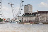 """TOW River Thames Barge Driving Race 2013: Barge """"""""Shell Bay"""" by South Dock Marina, with the London Eye and London Aquarium behind, close to the finish of the race at Westminster Bridge.. River Thames between Greenwich and Westminster, London,  United Kingdom, on 13 July 2013 at 14:23, image #445"""