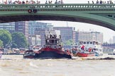 "TOW River Thames Barge Driving Race 2013: Barges on the way back to Greenwich, passing Hungerford Bridge, here tug ""Aicirton"" pulling barge ""Jane"", by the RMT Union.. River Thames between Greenwich and Westminster, London,  United Kingdom, on 13 July 2013 at 14:42, image #515"