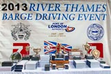 TOW River Thames Barge Driving Race 2013: The prizes for the 2013 Thames Barge Driving Race on the presentation stage, before the price-giving.. River Thames between Greenwich and Westminster, London,  United Kingdom, on 13 July 2013 at 15:39, image #556