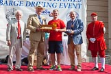 "TOW River Thames Barge Driving Race 2013: The ""Steven Bennet Memorial Trophy"", presented to the apprentice on the winning barge, goes to M. O'Doherty of barge  ""Blackwall"", by the Port of London Authority.. River Thames between Greenwich and Westminster, London,  United Kingdom, on 13 July 2013 at 16:28, image #578"