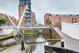 BCN Marathon Challenge 2014: A very modern footbridge over the Birmingham & Fazeley Canal at the Farmers Bridge locks, with old industry on the right. The factory bridge on the right used once served a saw mill.. Birmingham Canal Navigation,   United Kingdom, on 23 May 2014 at 14:20, image #23