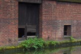 BCN Marathon Challenge 2014: The only inhabitants of this old factory or warehouse seem to be pigeons. The rings on the wall indicate that the door might have been used for loading/unloading. Garrison Locks, Grand Union Canal. Birmingham Canal Navigation,   United Kingdom, on 24 May 2014 at 08:46, image #80