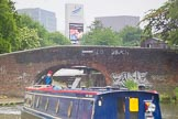 "BCN Marathon Challenge 2014: Narrowboat Felonious Mongoose leaving Aston Top Lock on the Birmingham & Fazeley Canal, just below a huge Birmingham Science Park billboard for ""Show Boat"".. Birmingham Canal Navigation,   United Kingdom, on 24 May 2014 at 10:26, image #105"