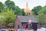 "BCN 24h Marathon Challenge 2015: BCNS chairman Charley Johnston steering ""Felonious Mongoose"" through Icknield Port Loop, with the Dhammatalaka Peace Pagoda (Birmingham Buddhist Vihara) behind. Birmingham Canal Navigations,    on 23 May 2015 at 08:51, image #19"