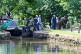 : Narrowboat Maria is ready to leave Marple bottom lock, boat horse Bilbo is on the way to pick up the tow line.     on 03 July 2015 at 15:32, image #34