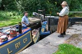 : CRT's Richard Parry and Horseboat Association's Sue Day at lock 2 of the Marple flight. To get butty Maria into a lock, the big rudder has to be pulled to the side, and the tiller has to be removed..     on 03 July 2015 at 15:42, image #44