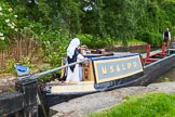 : Barbara Homes (Ashton Packet Boat Co) wearing a traditional bonnet, stears historic narrowboat Maria (built 1854) out of Marple lock 14..     on 03 July 2015 at 18:03, image #93
