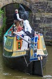 : Barbara Homes (Ashton Packet Boat Co) wearing a traditional bonnet, stears historic narrowboat Maria (built 1854) into of Marple lock 15..     on 03 July 2015 at 18:03, image #94
