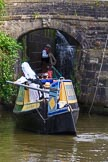 : Barbara Homes (Ashton Packet Boat Co) wearing a traditional bonnet, stears historic narrowboat Maria (built 1854) into of Marple lock 15..     on 03 July 2015 at 18:04, image #95