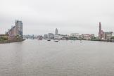 Thames Diamond Jubilee Pageant: The flotilla of narrowboats emerging below Battersea Rail Bridge. River Thames seen from Battersea Bridge, London,  United Kingdom, on 03 June 2012 at 15:50, image #440