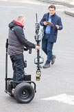 Lord Mayor's Show 2013: The BBC's Chris Hollins and a stedycam-operator on a Segway.. Press stand opposite Mansion House, City of London, London, Greater London, United Kingdom, on 09 November 2013 at 09:25, image #49