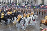 Lord Mayor's Show 2013: The Mounted Band of the Household Cavalry. Behind them The London Regiment, Guard of Honour for the Lord Mayor.. Press stand opposite Mansion House, City of London, London, Greater London, United Kingdom, on 09 November 2013 at 10:48, image #86