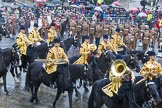 Lord Mayor's Show 2013: The Mounted Band of the Household Cavalry. Behind them The London Regiment, Guard of Honour for the Lord Mayor.. Press stand opposite Mansion House, City of London, London, Greater London, United Kingdom, on 09 November 2013 at 10:48, image #87