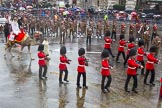 Lord Mayor's Show 2013: 6-Worshipful Company of Grocers- The Spice of Life, represented by the Coldstream Guards, G Company 7th Rifles,here they are joined by Cocoso the camel.. Press stand opposite Mansion House, City of London, London, Greater London, United Kingdom, on 09 November 2013 at 11:02, image #170