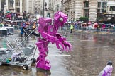 Lord Mayor's Show 2013: 59-Recycling in the City- The Binbot is joined again by his drumming street sweepers to celebrate 20th anniversary of the City's unique Clean City Awards scheme.. Press stand opposite Mansion House, City of London, London, Greater London, United Kingdom, on 09 November 2013 at 11:32, image #745