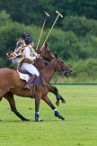 7th Heritage Polo Cup semi-finals: Rosie Ross leads on the ball. Barbara P Zingg on the ride off.. Hurtwood Park Polo Club, Ewhurst Green, Surrey, United Kingdom, on 04 August 2012 at 13:32, image #144