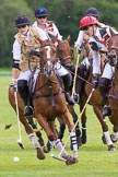 7th Heritage Polo Cup semi-finals: Sarah Wisman is off followed by Heloise Lorentzen.. Hurtwood Park Polo Club, Ewhurst Green, Surrey, United Kingdom, on 04 August 2012 at 13:33, image #153