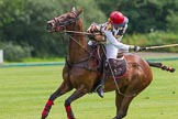 7th Heritage Polo Cup semi-finals: Sarah Wisman taking a nearside backshot.. Hurtwood Park Polo Club, Ewhurst Green, Surrey, United Kingdom, on 04 August 2012 at 13:35, image #158