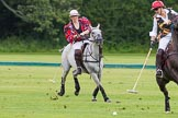 7th Heritage Polo Cup semi-finals: Sarah Wisman of the Ladies of the British Empire gently turning the ball, followed by Erin Jones from South Africa.. Hurtwood Park Polo Club, Ewhurst Green, Surrey, United Kingdom, on 04 August 2012 at 14:23, image #216