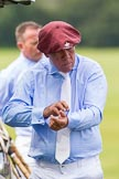 7th Heritage Polo Cup semi-finals: La Mariposa Argentina Mariano Darritchon putting on his T.M.Lewin Luxury Twill Shirt and cufflinks.. Hurtwood Park Polo Club, Ewhurst Green, Surrey, United Kingdom, on 04 August 2012 at 15:23, image #226
