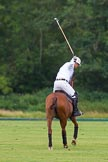 7th Heritage Polo Cup semi-finals: La Golondrina Argentina Polo Patron Paul Oberschneider in T.M.Lewin LuxuryWhite Twill Shirt taking a full swing.. Hurtwood Park Polo Club, Ewhurst Green, Surrey, United Kingdom, on 04 August 2012 at 15:25, image #234