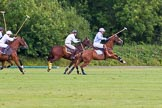 7th Heritage Polo Cup semi-finals: La Mariposa Argentina Timothy Rose following the ball with Brownie Taylor on his side.. Hurtwood Park Polo Club, Ewhurst Green, Surrey, United Kingdom, on 04 August 2012 at 15:53, image #293