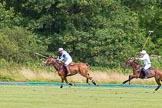 7th Heritage Polo Cup semi-finals: Mariano Darritchon braking away followed by Paul Oberschneider.. Hurtwood Park Polo Club, Ewhurst Green, Surrey, United Kingdom, on 04 August 2012 at 16:17, image #324
