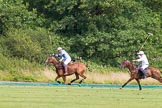 7th Heritage Polo Cup semi-finals: Mariano Darritchon braking away followed by Paul Oberschneider.. Hurtwood Park Polo Club, Ewhurst Green, Surrey, United Kingdom, on 04 August 2012 at 16:17, image #325