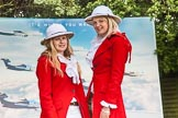7th Heritage Polo Cup finals: Liberty Freedom Sandhurst Red Coats & Ascot Top Hats Pith Helmets worn by Camilla Lovegrove and Serena Lillington-Price at the Entrance of  Hurtwood Park Polo Club.. Hurtwood Park Polo Club, Ewhurst Green, Surrey, United Kingdom, on 05 August 2012 at 11:58, image #3