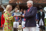 "7th Heritage Polo Cup finals: Sponsor Claire Cotton of ""Cotton & Gems"" presenting the Trophy  HERITAGE POLO CUP to  WINNER 2012 Silver Fox Polo Patron Parke Bradley.. Hurtwood Park Polo Club, Ewhurst Green, Surrey, United Kingdom, on 05 August 2012 at 14:40, image #87"