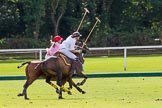 7th Heritage Polo Cup finals: Brownie Taylor being ridden off by Clare Payne.. Hurtwood Park Polo Club, Ewhurst Green, Surrey, United Kingdom, on 05 August 2012 at 15:40, image #185