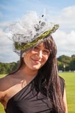 7th Heritage Polo Cup finals: Annabel Cattlin wearing one of her mother's Millinery Creations 2012.. Hurtwood Park Polo Club, Ewhurst Green, Surrey, United Kingdom, on 05 August 2012 at 16:48, image #229