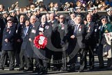 Remembrance Sunday 2012 Cenotaph March Past: The Fleet Air Arm Armourers Association, formed at the outbreak of WW2 to give firepower and air cover to the Atlantic convoys. With the Wreath Chief Petty Officer Mick Holdsworth, next to him the chairman, Detective Chief Inspector Mick Grubb QPM.. Whitehall, Cenotaph, London SW1,  United Kingdom, on 11 November 2012 at 11:39, image #92