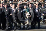 Remembrance Sunday 2012 Cenotaph March Past: Group E8 - The Fleet Air Arm Armourers Association, formed at the outbreak of WW2 to give firepower and air cover to the Atlantic convoys.. Whitehall, Cenotaph, London SW1,  United Kingdom, on 11 November 2012 at 11:39, image #93