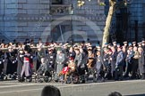 Remembrance Sunday 2012 Cenotaph March Past: Group C1, Blind Veterans UK, waiting for the rest of the column to get in line.. Whitehall, Cenotaph, London SW1,  United Kingdom, on 11 November 2012 at 11:53, image #773