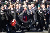 Remembrance Sunday 2012 Cenotaph March Past: Group D1 - South Atlantic Medal Association (www.sama82.org.uk), veterans of the Falklands war in 1982 and islanders from that time. The lady with the wreath and the grey hat is Sukey Cameron, the United Kingdom - Falkland Islands Government Representative.. Whitehall, Cenotaph, London SW1,  United Kingdom, on 11 November 2012 at 12:04, image #1206