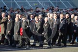 Remembrance Sunday 2012 Cenotaph March Past: Group M18 - Firefighters Memorial Charitable Trust, and M19 - Royal Ulster Constabulary (GC) Association.. Whitehall, Cenotaph, London SW1,  United Kingdom, on 11 November 2012 at 12:12, image #1545