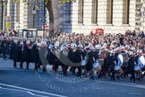 The Band of the Royal Marines, followef by a Royal Navy detachment, marching towards the Cenotaph.