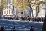 A detachment from from the Royal Navy, followed by the Royal Marines, marching along the northern side of Whitehall towards the Cenotaph.