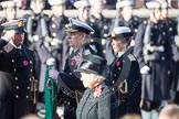 HRH The Duke of York, having received his wreath from his Equerry, Lieutenant Commander Michael Hutchinson, Royal Navy. Behind the Duke HRH The Princess Royal, and in the foreground and out of focus HM The Queen.