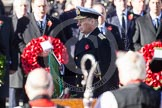 HRH The Duke of York, about to lay his wreath at the Cenotaph. In the foreground, and out of focus, the Bishop of London.
